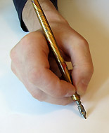 Holding a pen holder in the normal, open position.
